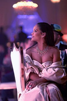 Rihanna looking like a pretty-in-pink princess. Bot her signature look but she slays it, obviously.