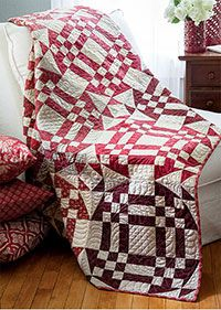 """Will You Walk into my Parlor Quilt Kit by Tony Jacobson Quilt size: 72"""" x 90"""" Finished Blocks: 20 (18"""") blocks Project Rating: Intermediate Using goodly portions of his red and tan scraps, designer Tony Jacobson wove a spider's web that's not to be denied. A handy tool, cutting diagrams, and strip-pieced nine patches make sure you will not get stuck. Kit includes fabric from Moda for the quilt top and binding. Instructions are included. This is a Fat Quarter Friendly Project."""