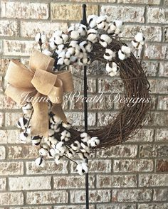 Cotton Boll Grapevine Wreath with Burlap Bow. Great indoor or outdoor wreath. By Jayne's wreath designs on fb and Instagram
