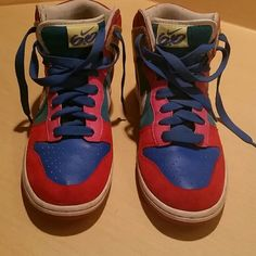 Nike limited addition high tops Are these not the cutest sneakers?!?! :) Suede and leather high tops, this is a limited edition collectors sneaker. Red suede toe and upper, leather blue, pink, white Nike stripe and yellow/red graphic heel.  Barely worn and never outside, beautiful condition. No box. Nike Shoes Sneakers