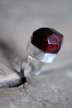 NOTE: Much like the raw garnets Dad gave me that he had collected as a boy.          loving this garnet ring
