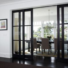 Love the sliding glass panel doors to separate and close off room for more privacy without feeling closed off.