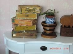 This is a collection of old cigar boxes, I keep jewelry in some, and hankerchiefs in some..