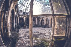 A dilapidated piano is pictured keeled over, in a crumbling atrium in an old Polish palace, captured by the 25-year-old photographer