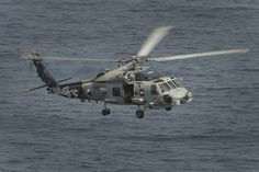 """GULF OF OMAN (June 21, 2013) An MH-60R Sea Hawk helicopter assigned to the """"Wolf Pack"""" of Helicopter Maritime Strike Squadron (HSM) 75 maneuvers over the Gulf of Oman. HSM 75 is part of Carrier Air Wing 11, currently deployed with Nimitz Strike Group to the U.S. 5th Fleet area of responsibility conducting maritime security operations, theater security cooperation efforts and support missions for Operation Enduring Freedom."""