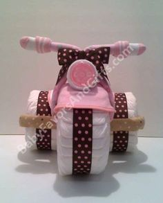 Precious girly girl diaper bike! New twist on the diaper cake.  This site has lots of cute baby shower ideas