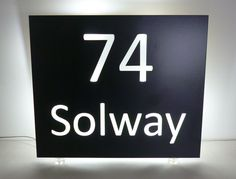 Illuminated sign finished in anthracite for a discerning customer who wanted to match window and door finish. For details on our bespoke design service contact us direct, at http://www.housenumbers.co.uk/stainless-steel-back-lit-house-name-100-p.asp