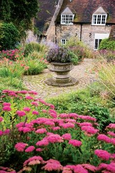 #English #garden in Oxfordshire, designed by Sarah Price and Alice Bowe... mellow stone, mossy brick and relaxed plantings soften the more formal elements