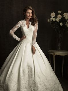 Shop the Look: Splurge Option: This gown features a v-shaped Queen Anne neckline with gorgeous sheer laced sleeves that continue across the back. It also comes with a detachable bow if you want to add an extra feminine touch to your look. Allure Bridals Kate Middleton Wedding Dress ($2,023)