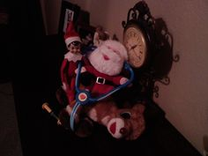 """Frizzy the Elf and Santa checking Rudolph's heartbeat. Needed to make sure he was ready for the """"BIG"""" day!"""