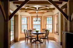 timber frame dining nook with bay windows