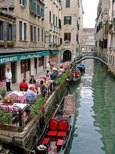 Kids will love eating at a restaurant along one of the smaller canals like this one Ristorante da Raffaele | Venice, Italy and watching all the boats go by!