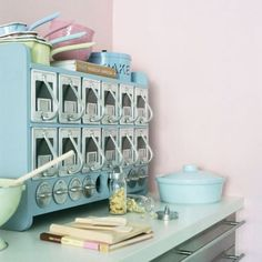 vintage kitchen storage. those little pill or spice bottles are amazing.