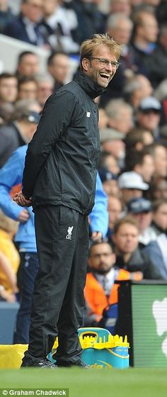 Jurgen Klopp watches from the sidelines