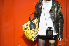 Model MingXi carries CHANEL NO5 Clutch bag and Jeremy Scott bag during New York Fashion Week NYFW