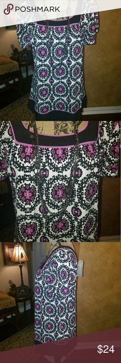 """BEAUTIFUL PRINTED KIM RODGERS TOP This is a darling top that is a multi print of deep fuchsia and black and white print. Brand new with tags. The material is 95% polyester with 5% spandex. Lots of stretch. Bust measurements are measured roughly 20 """" across. So beautiful. Kim Rogers Tops"""