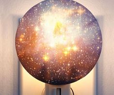 Hold the vast cosmos in the palm of your hand with the galaxy night light. This novelty night light features a realistic 3D printed photo of the galaxy that...
