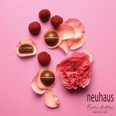 This fruity praline in milk chocolate has 2 layers; praliné with rose petals and praliné with tart raspberries. #neuhaus #chocolate #duopralines