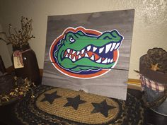 1000 images about wood pallet signs and rustic home decor by country clutter on pinterest - Florida gators bathroom decor ...