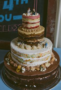 This multi flavour cake is perfect if you can't decide...I love it!  Brides: Unfrosted Wedding Cakes | Wedding Ideas