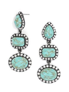 These long statements blend luxe stones in complementary hues, surrounded by crystal embellishments for added glamour.