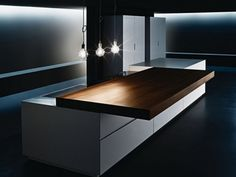 Contemporary sliding kitchen counter by Minimal.  The whole space really satisfies my OCD.
