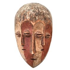 A superb triple face carved wooden mask from Sud-Kivu Province, Democratic Republic of the Congo. These ceremonial masks were used by Lega men to rise through the five levels of Bwami associated with lifelong learning and deeds.   The patina is wonderful, created by applying clay to the wood. The simplicity of the lines bring to mind much of European modern art, the masters of which borrowed heavily from African art.