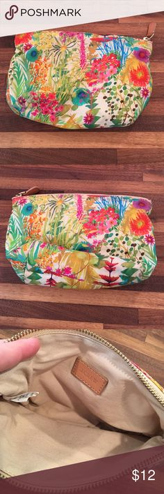 J.Crew Liberty Print Pouch Soft Liberty pouch. Beautiful vibrant print. Good used condition. Has been washed and is perfectly clean. No marks inside. J. Crew Bags Cosmetic Bags & Cases
