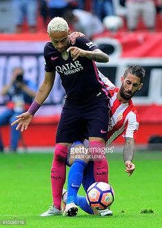 Barcelona's Brazilian forward Neymar da Silva Santos Junior vies with Sporting Gijon's defender Lillo Castellano during the Spanish league football...