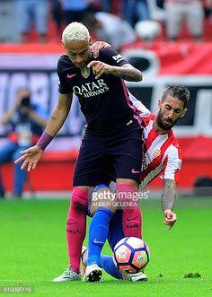 Barcelona's Brazilian forward Neymar da Silva Santos Junior vies with Sporting Gijon's defender Lillo Castellano during the Spanish league football...