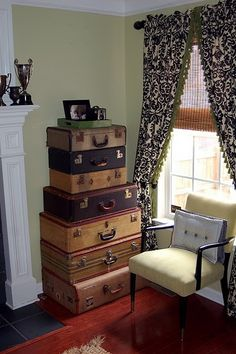 vintage suitcases - I have a few & don't know what to do with them - maybe something like this!