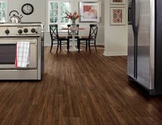 LVT.  Coretec Plus in Kingswood Oak 7 inch planks. Elegant distressed look and feel of real hardwood.  This product adds  Lifetime residential wear warranty and 10
