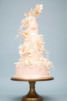 11 things to know about wedding cakes - White wedding cake with sugared flowers Orchid Wedding Cake, 5 Tier Wedding Cakes, Blush Wedding Cakes, Luxury Wedding Cake, Floral Wedding Cakes, Fall Wedding Cakes, Wedding Cake Decorations, Elegant Wedding Cakes, Wedding Cakes With Flowers