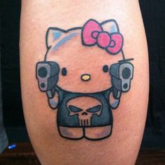 Pin for Later: The Cutest, Most Creative Hello Kitty Tattoos Punisher Kitty Punisher Tattoo, Cat Tattoo, Tattoo You, Hello Kitty Tattoos, Hello Kitty Birthday, Hello Kitty Wallpaper, Tatoos, Geek Tattoos, Kawaii Tattoos