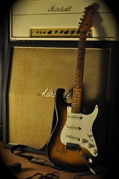 Fender Stratocaster Vintage guitar and Marshall Amp stack. Excellent shadows in picture cast interest into this brown tone photo. -DdO:) http://www.pinterest.com/DianaDeeOsborne/instruments-for-joy via Matthew Smith