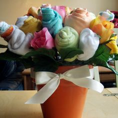 How cute is this.  A bouquet made of baby onsies!  tutorial at this link.