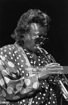 American jazz musician Miles Davis , wearing a polka dot outfit and aviator sunglasses, plays a trumpet on stage at the JVC Jazz Festival, New York City. Get premium, high resolution news photos at Getty Images Miles Davis, Jazz Festival, Jazz Musicians, Still Image, Darkness, Prince, Polka Dots, Concert, American