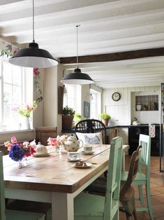 eclectic kitchen, love the pendants & mix of chairs..no upper cabinets