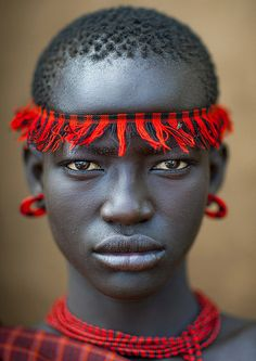 Miss Domoget, Bodi Tribe Woman With Headband, Hana Mursi, Omo Valley, Ethiopia by Eric Lafforgue