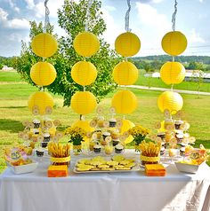 Sunshine Party, Spray paint bottles white for vases, yellow ribbon around hurricanes with flowers- LANIES SUN Month Pictures!