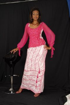 An African women's top and wrap around wrapper  made of white brocade and pink chiffon. Pink embroidery is sewn all over chest  area in swirls. Great for any young and middle aged woman.  Made with 100% authentic cotton brocade. Please DO NOT bleach, dry clean and press with warm iron.  F...