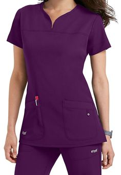 You'll love how you feel in the luxurious Grey's Anatomy Signature 2-pocket scrub top (in Dewberry)! This top is made of a 4-way stretch fabric that responds with agility, resilience, and grace.