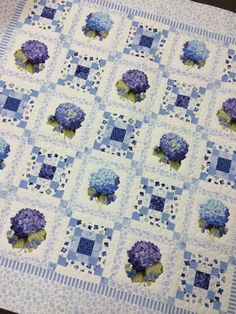 "hollyhillquiltshoppe.com ...      Lakehouse Blossom Chain Blue Quilt   Finished Size: 51"" x 51"" . Made with fabrics from Lakehouse collections . Excellent piecing by Dorene Kemp . Excellent Custom Machine Quilting by Monica Mesdag."