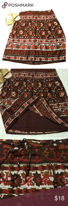 Ann Taylor cotton skirt Brown multi print with red, burgundy and light tan . Fully lined, 100% cotton. Classic flower and scrolls print. Side zip with functional drawstring with beads, waistline. Very gently worn, like new. Ann Taylor Skirts A-Line or Full