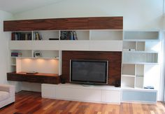 Entertainment unit with glass display shelving and desk|interfar.com.au