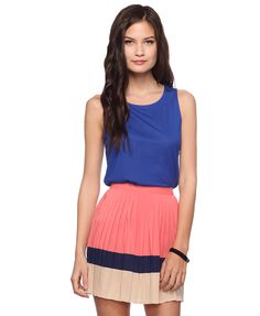 love the pleated skirt