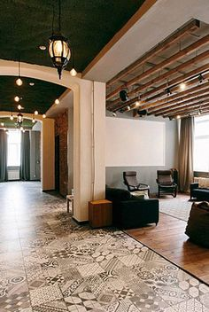 Salt Co-Working, Yekaterinburg, Russia: Common spaces like this one feature beanbag chairs on the floor and exposed beams on the ceiling.