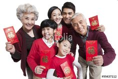 Happy family showing red pockets celebrating Chinese New Year