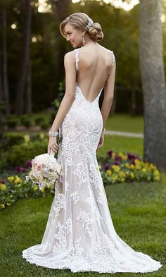 Gorgeous classic wedding dress by Stella York - totally elegant lace, open back. See more: http://www.weddingforward.com/24-most-gorgeous-wedding-dresses/ #weddingdresses #weddingdress