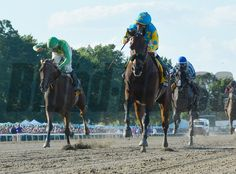 Triple Crown winner American Pharoah with jockey Victor Espinoza flies across the track  Sunday Aug. 2, 2015 at Monmouth Park in Oceanport, N.J. on his way to an easy win in the 48th running of The Haskell Invitational.    Skip Dickstein Photo